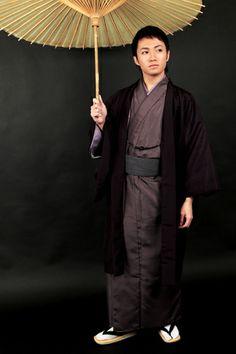 Male dressed in kimono.