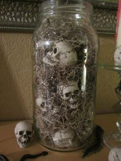 #Halloween #Skull #Jar - Pottery Barn's version is here:  http://www.potterybarn.com/products/mini-skull-vase-filler/?pkey=cvase-fillers .  My version was made with dollar store moss and miniature skulls in a big pickle jar.