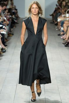 sleek and edgy black dress with a low v, that length we love and POCKETS! #MichaelKors #SS15 #pockets
