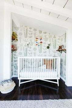 Love this Cactus wallpaper for a boho nursery. Gender nuetral baby room.