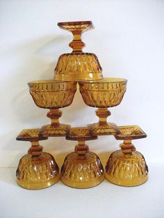 Vintage amber glass pedestal bowls Set of 6 Beautiful cut glass. Square footed pedestal footing. Glasses stand 4 in. tall Mouth is 3.5 wide Perfect