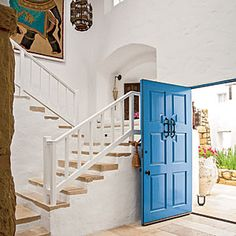 Entry - pop of blue on the front door -Romantic California Home Tour | A Touch of Whimsy | CoastalLiving.com
