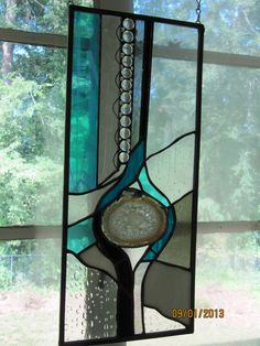 Custom stained glass panel by Art Glass: Inspired featuring an agate slice and stained glass in shades of aqua, black, white an clear textures --- www.artglassinspired.etsy.com