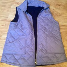 Gray / Navy Reversible Vest - Fits Medium/Large NOT J. CREW. Listed to acquire views. Purchased from small boutique! Worn once! Purchased at small boutique. Inside is fleece navy! Perfect condition! Smoke free home! Feel free to make an offer! J. Crew Jackets & Coats Vests