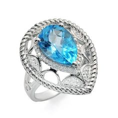 A dazzling pear shaped blue topaz gemstone sits in the center of this gorgeous white gold ring. The blue topaz is prong set and is accented by 25 round prong set diamonds. The diamonds have G/H color and clarity. Blue Topaz Diamond, Topaz Gemstone, Gemstone Rings, Ring Sizes, Prong Set, Pear Shaped, White Gold Rings, Diamond Rings, Clarity