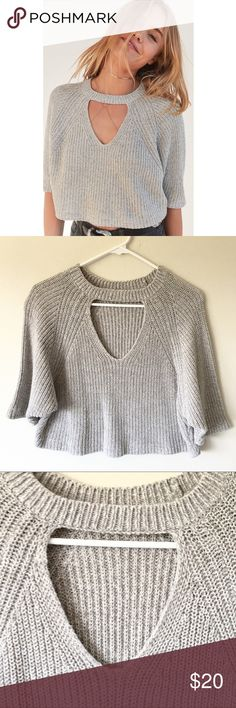 Maddie Cutout Cropped Sweater Silence + Noise Maddie Cutout Cropped Sweater from Urban Outfitters. Color is gray. Size S or M (took off tag & cant remember) but would fit both. Worn only once & in perfect condition. Urban Outfitters Tops Crop Tops
