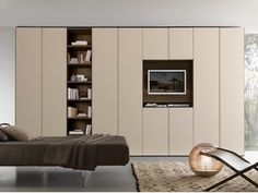 Sectional wardrobe with built-in TV LISCIA Tecnopolis Collection by Presotto Industrie Mobili Wardrobe Tv, Wardrobe Cabinets, Wardrobe Storage, Bedroom Wardrobe, Wardrobe Design, Built In Wardrobe, Bedroom Storage, Armoire En Pin, Armoire D'angle