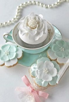 Beautiful cup cake and flower cookies tea time