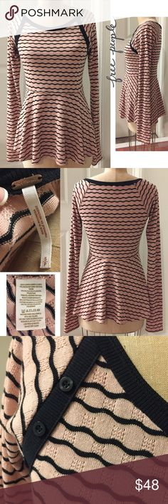 """NWOT FREE PEOPLE fine knit pullover with button NWOT FREE PEOPLE fine knit pullover with button detail, flared bottom, approx 26"""" long, so pretty!  x1532. SMOKE & PET FREE HOME. ❤️If you like an item, DON'T WAIT!  Make a reasonable offer.  Once it's gone, there's no bringing it back😊 Free People Tops Tunics"""