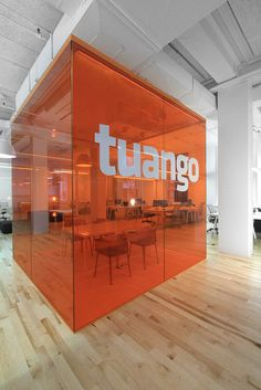 I know this is in an office, but this transparent wall/divider would work great as a trade show booth