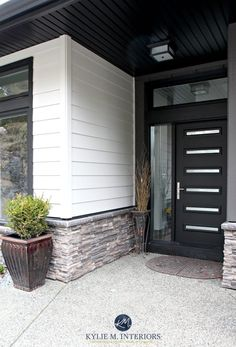 A Contemporary and Comfortable New Home in Nanaimo Contemporary exterior with James Hardi Cobblestone siding, black front door, soffits and stone. Kylie M INteriors E-design Modern Exterior Doors, House Paint Exterior, Exterior Siding, Exterior Remodel, Exterior House Colors, Exterior Design, Stucco Colors, Bungalow Exterior, Wood Exterior Door