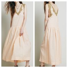 FREE PEOPLE Dress Drop Waist Gauze Swing Long Maxi Size Euro 38, US 6 (Small).  New with tags. $377 Retail + Tax.  Drop waist sheer maxi with side buttons.  Neckline features crochet inset style lace trim & raw edges. Slip dress included.   By Mes Demoiselles for Free People.   Ramie. Imported.   ❗️ No trades or holds.   💰 Bundle 2+ items for a 20% discount!   👠 Stop by my closet for even more items from this brand!  ✔️ Items are priced to sell, however reasonable offers will be considered…