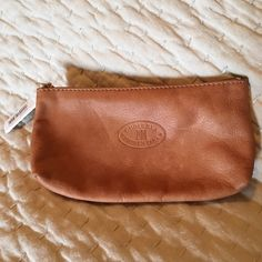 Italian Leather zipper pouch Leather zipper pouch purchased from Florence, Italy. 100% Italian leather. Gusseted at bottom to allow space for items inside.  Tag attached with euro price point on it. Raw leather inside. Tan color. Perfect for lipstick or loose money. Bags Cosmetic Bags & Cases