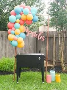 Create a popsicle station for summer parties with a stand-up cooler. See more from this Grad Party on Mint Event Design www.minteventdesign.com #graduationparty #graduationpartyideas #graduation #gradparty #gradpartyideas #partydecor