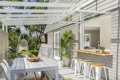 Three Birds Renovations transform an outdoor space. This inviting area features a cut to measure timber ledge available at Bunnings. Outdoor Areas, Outdoor Rooms, Outdoor Living, Outdoor Decor, Indoor Outdoor, Outdoor Blinds, Alfresco Designs, Alfresco Ideas, Side Yard Landscaping