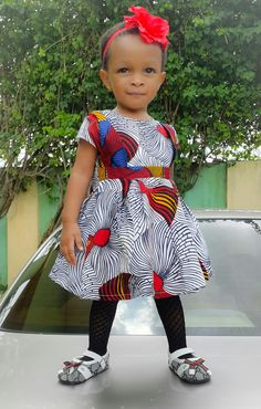 Cute stylish Toddler ankara African print dress by IMaka African Dresses For Kids, African Children, African Print Fashion, Fashion Prints, Stylish Outfits, Kids Outfits, Ankara Styles, African Fabric, Cool Kids