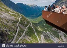 Scenic observation platform overlooking Trollstigen (Troll's Ladder) switchback mountain road in Norway's Romsdal Alps Stock Photo