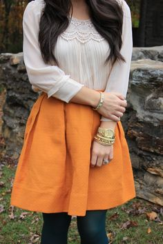Orange skirt + cream blouse paired with leggings and gold accents for a cute fall fashion outfit.