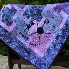 I made this quilt of pink, purple, and aqua batiks for our nanny.  Jack provided the artwork for the appliqué.  #DIY #Quilts #NannyGift