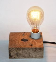 The minimalist shape of this desk lamp is meant to inspire and enhance your workspace, maybe even enough to shake the lingering moments of writer's block. Crafted from reclaimed oak wood, the lamp base has plenty of character from the flaws, the knot and hole prominently on display. The square shape is fitted with a flip switch and an Edison bulb.