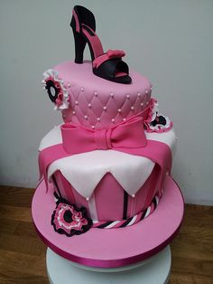 Pink topsy turvy cake with shoe