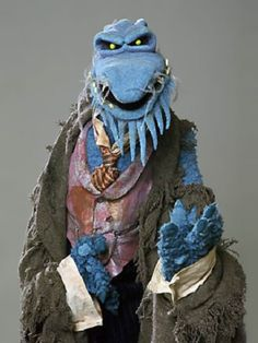 """Uncle Deadly. Uncle Deadly is a blue, reptilian-looking creature, also known as """"The Phantom Of The Muppet Show""""."""
