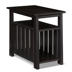 Total Transformation. The Tribute chairside table may look ordinary at first glance, but you'll soon see why we are head over heels for it. The mission-style vertical slatting provides a handsome exterior that's done in a lightly distressed, rubbed black finish that works well with most styles and color schemes. The lower open compartment has plenty of room for your favorite magazines or the latest best seller, while the upper space includes a pull-out tray with cupholders. Customer assem...