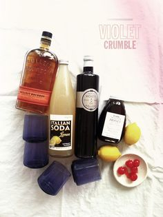 Violet Crumble  • 4 oz creme de violette • 1 liter of lemon soda (or make your own with fresh squeezed lemon juice and club soda!) • 4 oz honey syrup • lemon wedges • maraschino cherries (and a couple spoonfuls of the syrup, too) • a bunch of ice • gin AND whiskey