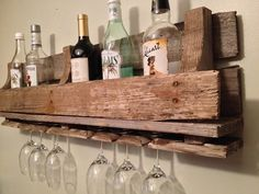 Reclaimed/Pallet Wood Wine Rack by RockPaperSawzall on Etsy, $65.00   Why not make it yourself :)