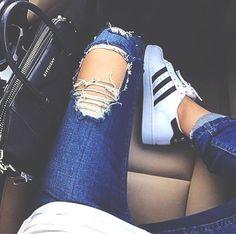 Sneakers + distressed denim.
