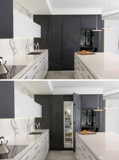 Kitchen Design Idea - 10 Inspirational Examples Of Kitchens With Integrated Fridges // Dark cabinetry seamlessly hides the fridge in this modern two-tone kitchen.