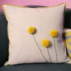 Simple DIY Dandelion Pom Pom Pillow via West Elm blog