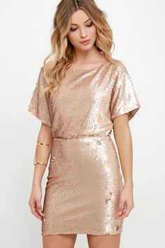 Dazzle up your wardrobe and let it shine like gold in the Glory Never Fades Rose Gold Sequin Dress! A sultry boat neck bodice has short dolman sleeves with slits along the tops, and tucks into an elastic waistline and fitted tube skirt. Open back slit has a top button closure. Hidden back zipper/clasp closure.