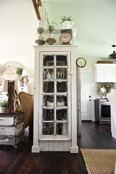 DIY Rustic window cabinet - so easy to build! This cabinet would be great in any room of the house for pretty storage. A great idea to add wrapping paper to the back of the cabinet for a pop of color. Farmhouse Style, Farmhouse Decor, City Farmhouse, French Farmhouse, Modern Farmhouse, Bookshelves Built In, Built Ins, Living Room Remodel, Kitchen Remodel