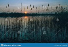 Photo about Natural gravel lake. Photographed at sunset. Slovakia. Image of gravel, adventure, lake - 214471796 Granite, Stock Photos, Celestial, Adventure, Sunset, Natural, Image, Outdoor, Outdoors