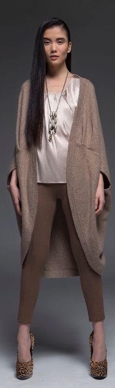 This fantastic cashmere open cardigan will make you want the cold weather to never end. With its cocoon rounded silhouette, subtle ruched detailing in the center and wide three-quarter length sleeves, wear this chic item as a hip-length open cardigan or a mid-thigh length dress.