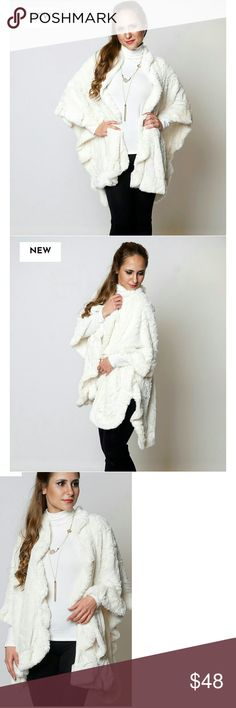 Faux fur cape Super trendy,  soft and comfy warm winter white cape from the UK.  this is not stark white, but winter white. Feels very luxurious when wearing. Can be worn with a belt for a more fitted look.  I have this in beige and charcoal also.  Check other listings for more details. Jackets & Coats Capes