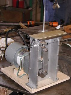 Die Filer by Jerry Hine -- Homemade die filer constructed from steel plate, bushings, a file, and an electric motor. http://www.homemadetools.net/homemade-die-filer-4