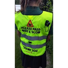 This high visibility tabard has been designed to encourage motorists to drive safely around horses.  http://www.totally-tack.co.uk/p_3509_hack-cam-please-pass-wide-slow-tabard-and-camera