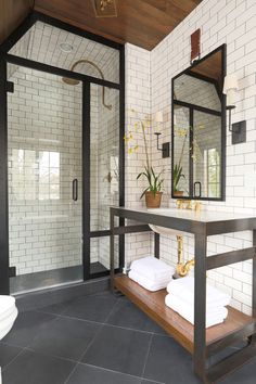 Chich bathroom with modern shower cabin and white brick tiles