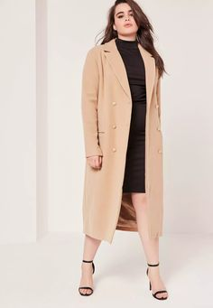 Nail daytime chic with this camel faux wool duster coat.