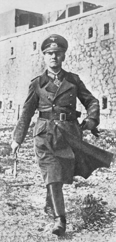 FIRST PUBLICATION IN THE EVENING PAPERS, FRIDAY, DECEMBER 31ST, 1943 Just received in London from a neutral source, this photograph shows Field-Marshal Rommel, wearing his Iron Cross and carrying his baton, inspecting German defences in the coastal area of Western Europe. Rommel has superseded von Rundstedt as invasion defence chief. (Photo by Planet News Archive/SSPL/Getty Images)