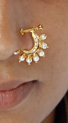 22 Karat Gold Nath - Nose Ring - Gold Nose hoop with Cz , Ruby & Pearls This item does NOT have any diamonds in it. The white stones in this item are Cubic Nath Nose Ring, Nose Ring Jewelry, Diamond Nose Ring, Ankle Jewelry, Jewelry Design Earrings, Gold Earrings Designs, Big Earrings, Jewellery, Gold Ring Designs