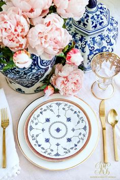 Easter table - pink peonies - ginger jars Blue spode, ginger jars and pink flowers with gold flatware