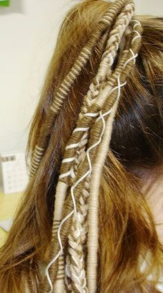 wrapped hair - also thread silver or gold charms in or beads, clear,pearl so it does not look as gyspy