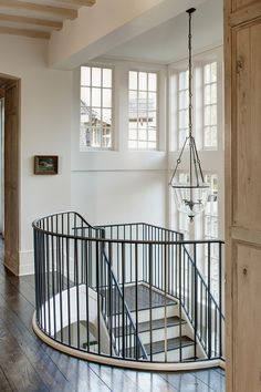 Love these floors, railing, curved overlook and ceiling