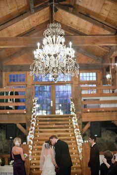 An elegant barn wedding with a gorgeous chandelier