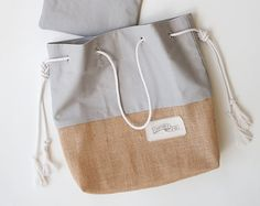 The Original Sandbag Beach Bag in Grey / Gray Canvas Finally one of the biggest summer problem solved. The Sandbag was designed to prevent sand from sneaking into your beach bag, getting all over your phone & sunglasses, and ending up on your floor at home. The top is made from our