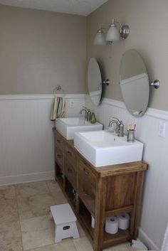 Dresser turned into double vanity.  Or console table.  I need a skinny vanity with two sinks for a long narrow bathroom.  Like the bowl sinks but the square might be too modern?  Still, love this idea.