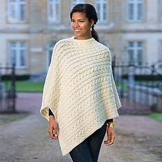 The horseshoe cable stitch of this cream colored Irish Aran Wool Poncho is as as beautiful it is cozy